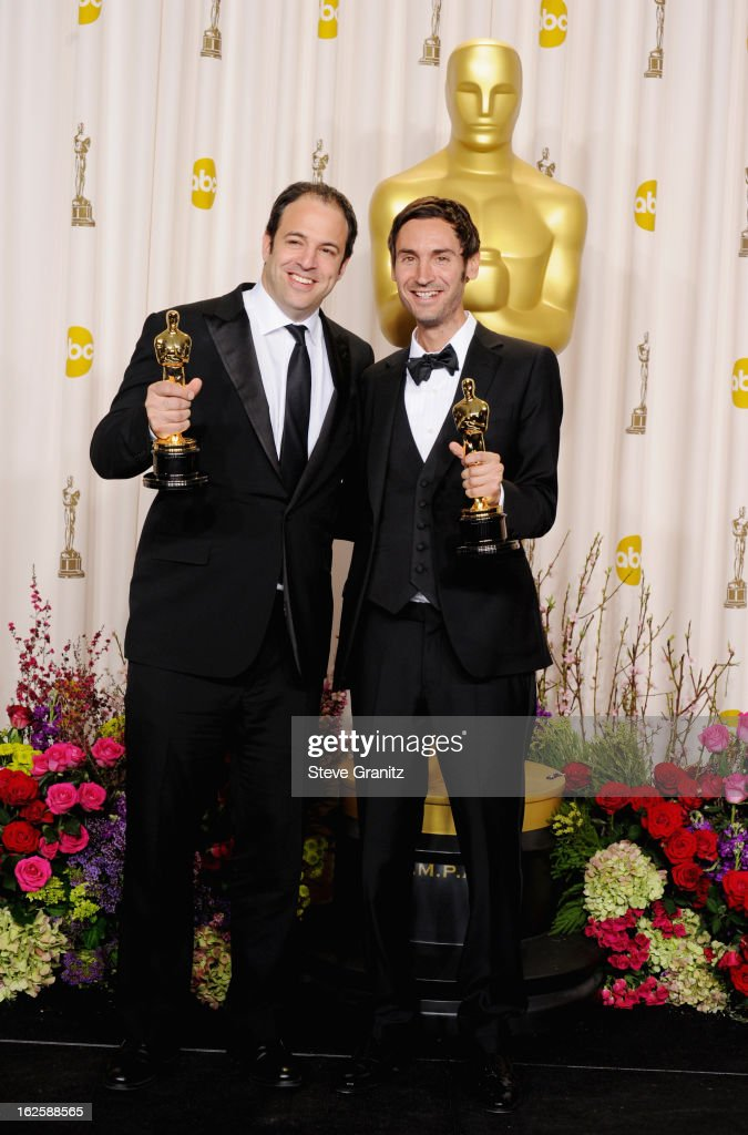 Malik Bendjelloul and Simon Chinn pose in the press room during the Oscars at the Loews Hollywood Hotel on February 24, 2013 in Hollywood, California.