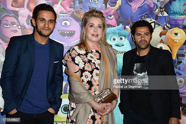 Malik Benthala Catherine Deneuve and Djamel Debbouze attend the Paris premiere of 'Monsters University' at La Sorbonne on June 26 2013 in Paris France