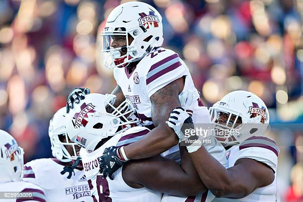 Malik Dear of the Mississippi State Bulldogs celebrates with teammates after catching a pass for a touchdown in the first half of a game against the...