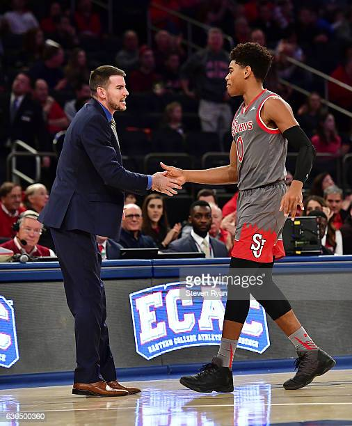 Malik Ellison meets with assistant coach Greg St Jean of the St JohnÕs Red Storm against the Penn State Nittany Lions at Madison Square Garden on...
