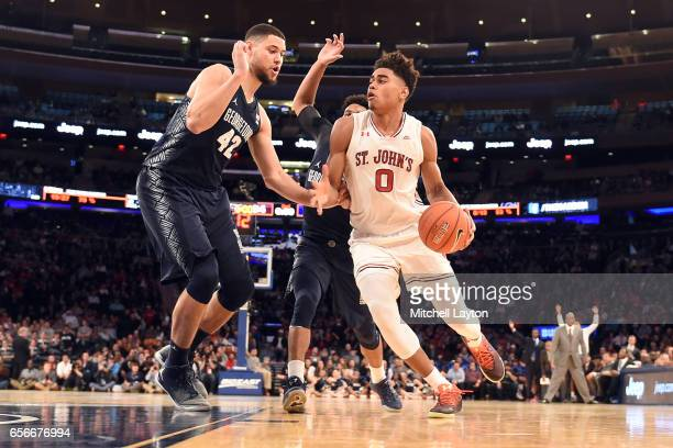 Malik Ellison of the St John's Red Storm dribbles around Bradley Hayes of the Georgetown Hoyas during the Big East Basketball Tournament First Round...