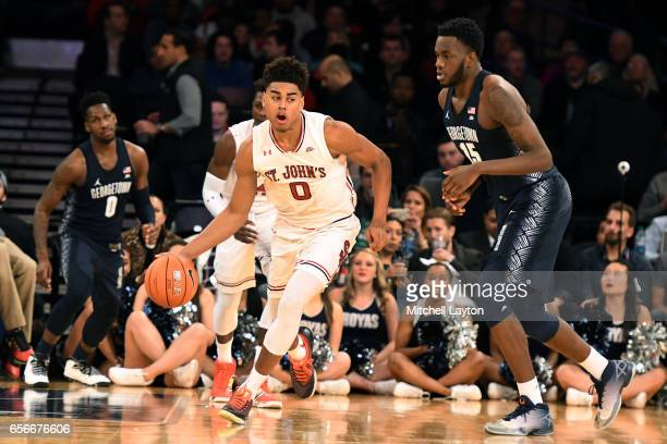 Malik Ellison of the St John's Red Storm dribbles past Jessie Govan of the Georgetown Hoyas during the Big East Basketball Tournament First Round...
