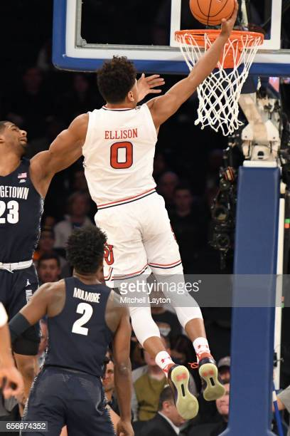 Malik Ellison of the St John's Red Storm drives to the basket during the Big East Basketball Tournament First Round game against the Georgetown Hoyas...