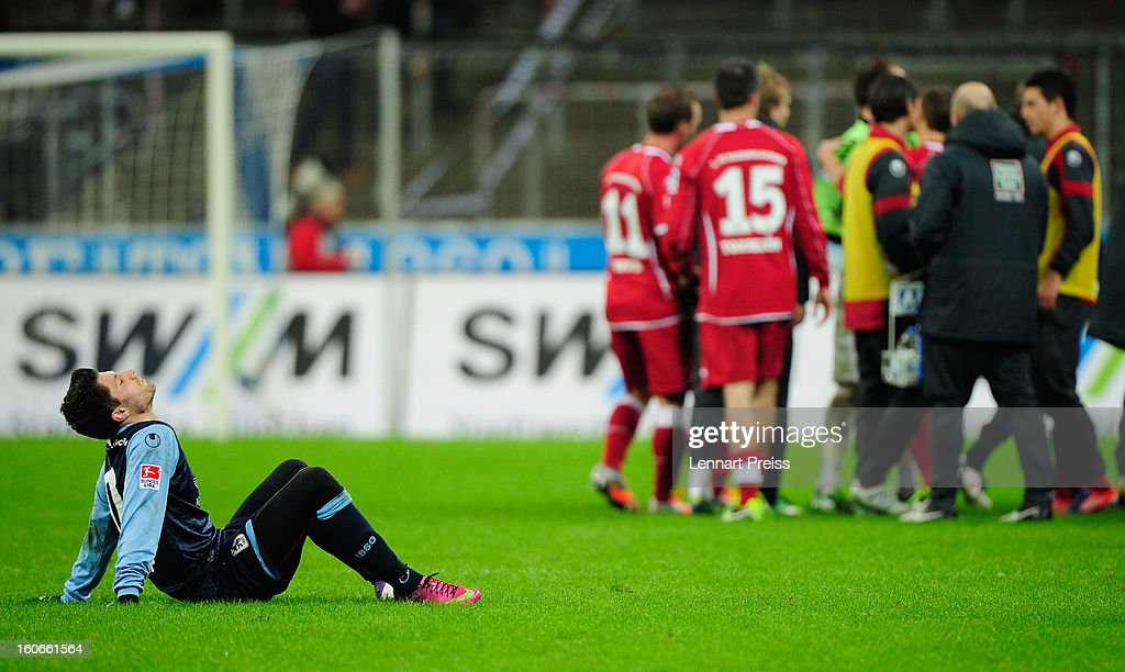 Malik Fatih (L) of Muenchen sits on the pitch after the Second Bundesliga match between TSV 1860 Muenchen and 1. FC Kaiserslautern at Allianz Arena on February 4, 2013 in Munich, Germany.