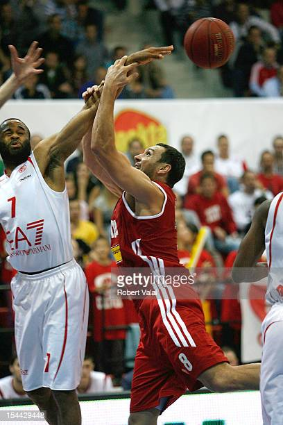 Malik Hairston #7 of EA7 Emporio Armani Milano competes with Predrag Suput #8 of Cedevita Zagreb during the 20122013 Turkish Airlines Euroleague...