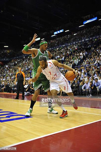 Malik Hairston of the EA7 Emporio Armani Milano drives against Paul Pierce of the Boston Celtics during the game between the Boston Celtics and the...