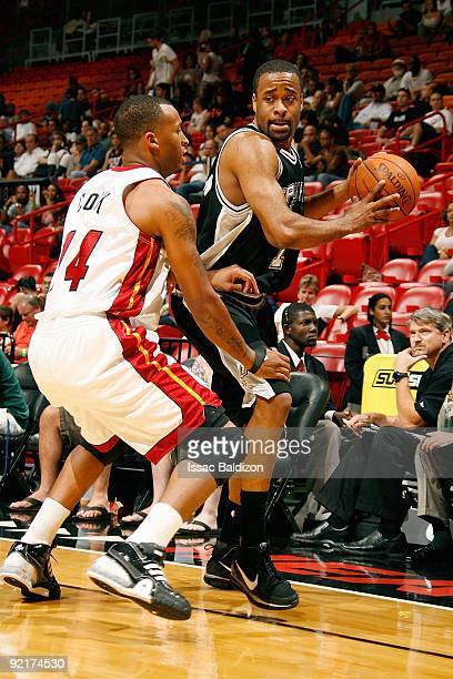Malik Hairston of the San Antonio Spurs drives the ball against Daequan Cook of the Miami Heat during the preseason game on October 11 2009 at...