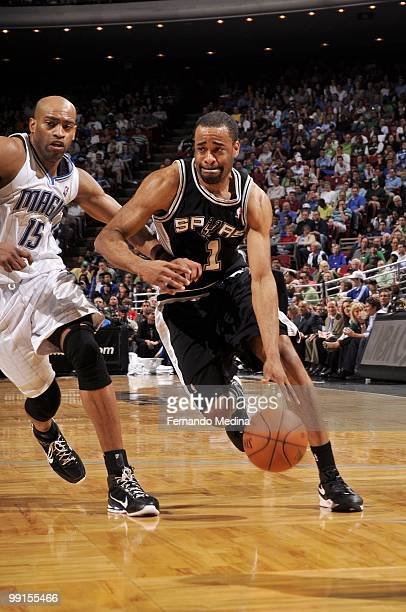 Malik Hairston of the San Antonio Spurs drives the ball against the Orlando Magic during the game at Amway Arena on March 17 2010 in Orlando Florida...