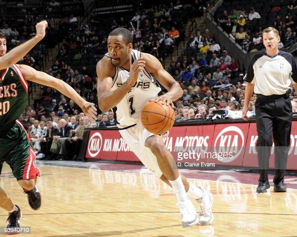 Malik Hairston of the San Antonio Spurs drives the ball up court during the game against the Milwaukee Bucks at ATT Center on November 23 2009 in San...