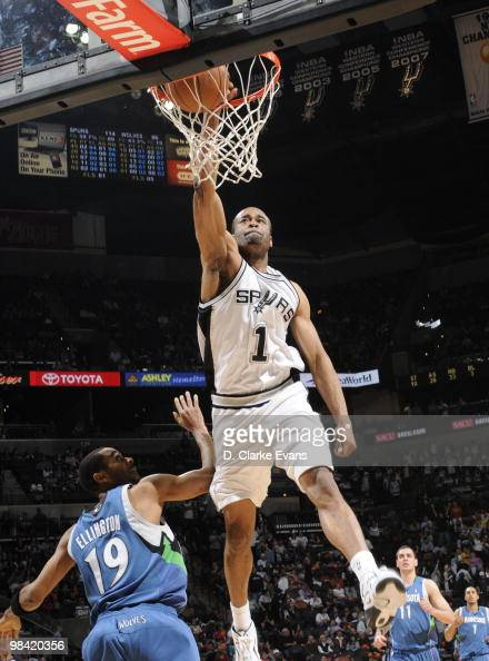 Malik Hairston of the San Antonio Spurs dunks over Wayne Ellington of the Minnesota Timberwolves on April 12 2010 at the ATT Center in San Antonio...