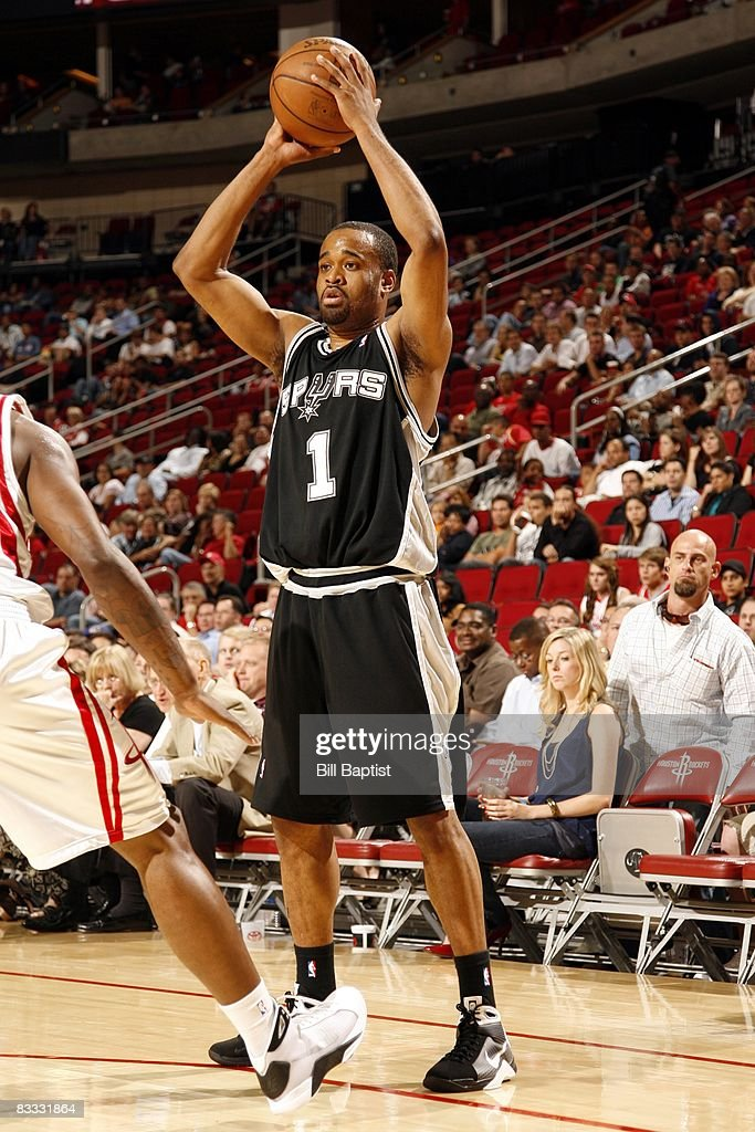 Malik Hairston #1 of the San Antonio Spurs looks to pass during the game against the Houston Rockets at the Toyota Center on October 9, 2008 in Houston, Texas. The Rockets won 85-78.