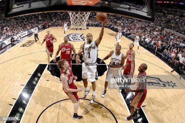 Malik Hairston of the San Antonio Spurs shoots a layup against Coby Karl of the Cleveland Cavaliers during a preseason game at ATT Center on October...