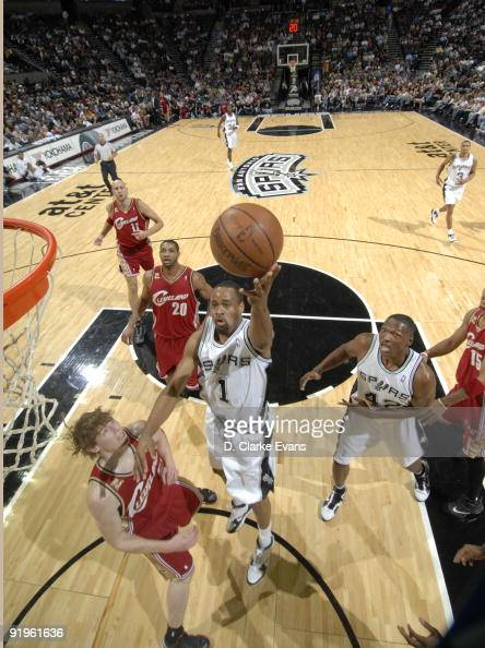Malik Hairston of the San Antonio Spurs shoots over Coby Karl of the Cleveland Cavaliers on October 16 2009 at the ATT Center in San Antonio Texas...