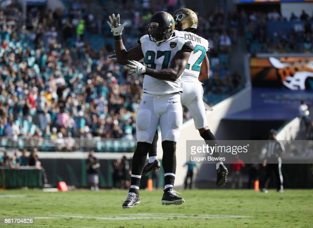 Malik Jackson and Aaron Colvin of the Jacksonville Jaguars celebrate a play in the first half of their game against the Los Angeles Rams at EverBank...