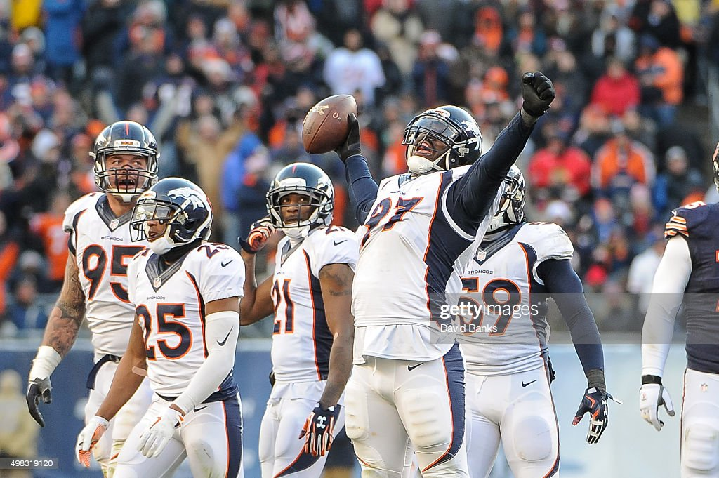 Malik Jackson of the Denver Broncos celebrates after intercepting the football against the Chicago Bears in the fourth quarter at Soldier Field on...