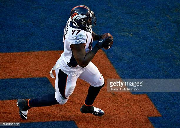 Malik Jackson of the Denver Broncos celebrates in the end zone after scoring the Broncos first touchdown of the game in the first quarter The Denver...