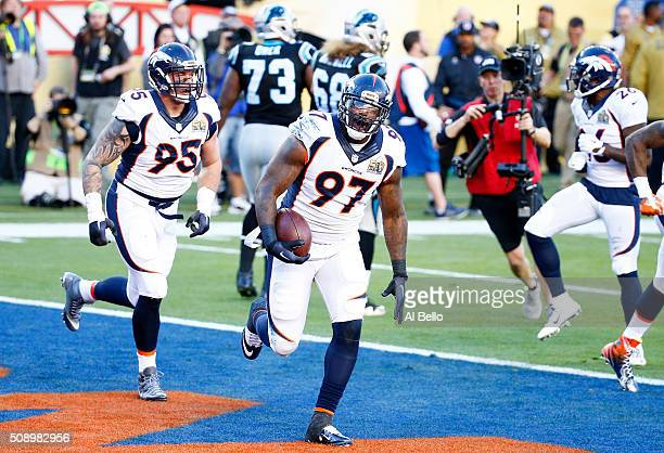 Malik Jackson of the Denver Broncos celebrates with teammates after recovering a fumble for a first quarter touchdown against the Carolina Panthers...