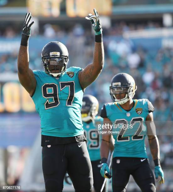 Malik Jackson of the Jacksonville Jaguars celebrates a play on the field in the second half of their game against the Cincinnati Bengals at EverBank...