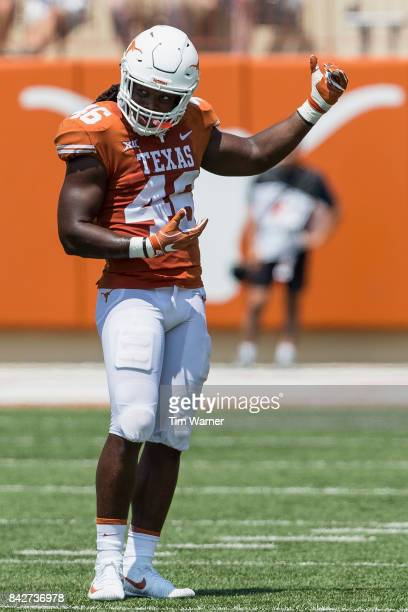 Malik Jefferson of the Texas Longhorns reacts after a tackle in the third quarter against the Maryland Terrapins at Darrell K RoyalTexas Memorial...