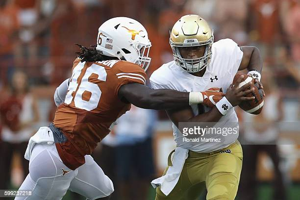 Malik Jefferson of the Texas Longhorns sacks DeShone Kizer of the Notre Dame Fighting Irish during the first half at Darrell K RoyalTexas Memorial...