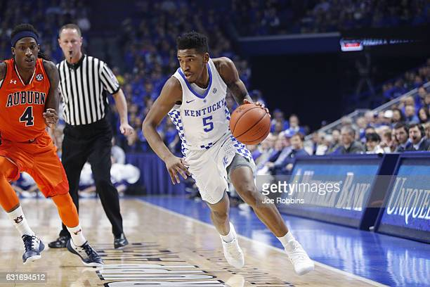 Malik Monk of the Kentucky Wildcats drives to the basket against TJ Dunans of the Auburn Tigers in the first half of the game at Rupp Arena on...