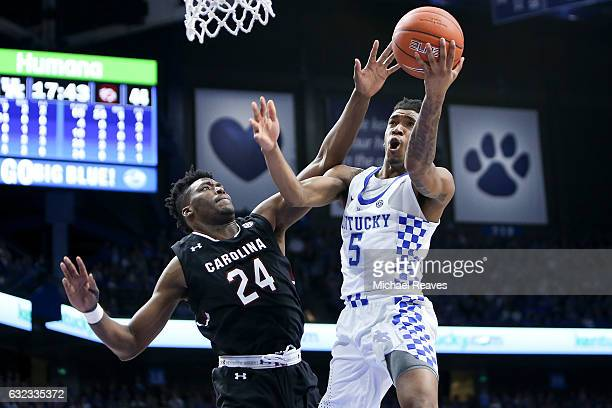 Malik Monk of the Kentucky Wildcats puts up a layup defended by Sedee Keita of the South Carolina Gamecocks during the second half at Rupp Arena on...