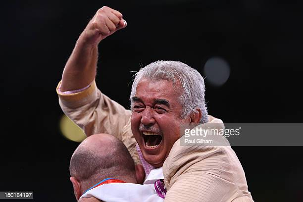 Malik Nadirbekov coach of Artur Taymazov of Uzbekistan celebrates a gold medal in the Men's Freestyle 120 kg Wrestling on Day 15 of the London 2012...
