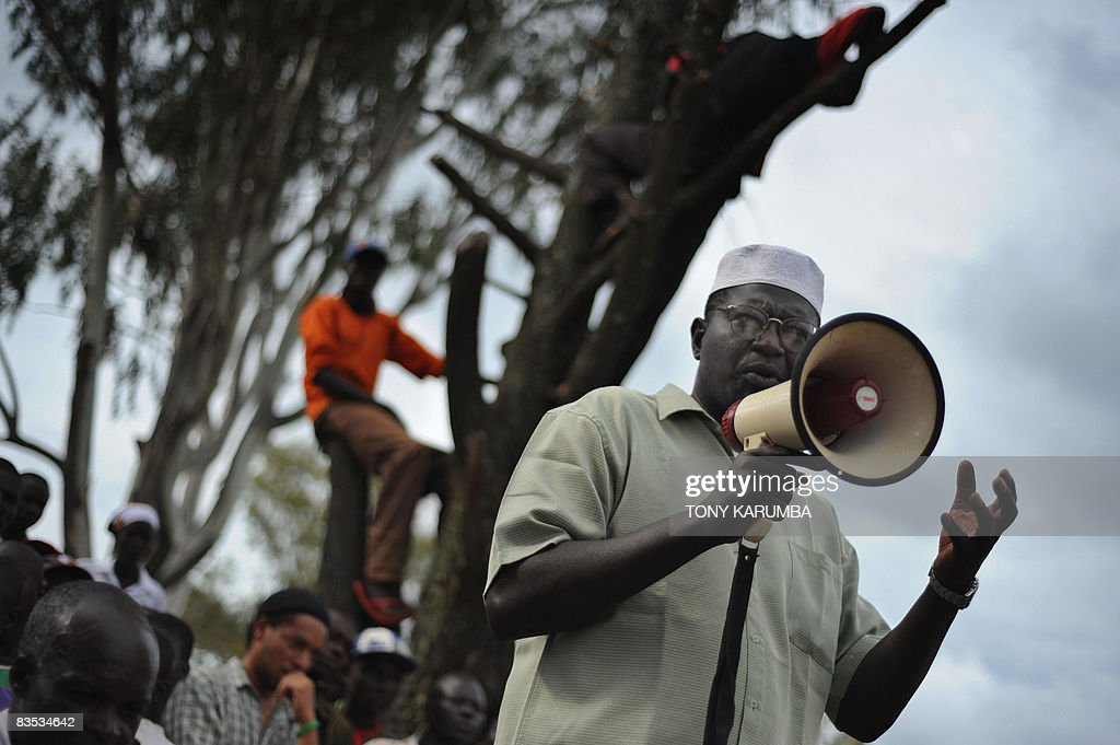 Malik Obama a step brother to America's Democratic presidential hopeful Barak Obama talks with the aid of a bulhorn November 2 2008 to villagers at...