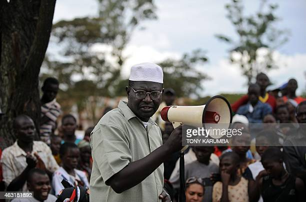 Malik Obama a step brother to US Democratic presidential hopeful Barak Obama talks with the aid of a bulhorn November 2 2008 to villagers at Kogelo...