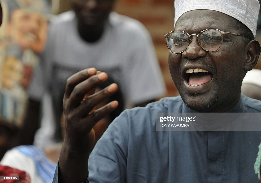 Malik Obama halfbrother of America's President elect Barack Obama smiles November 05 2008 at his Kogelo village residence where he gave a press...