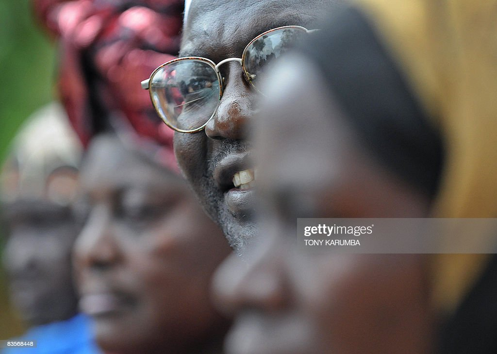 Malik Obama halfbrother of America's President elect Barack Obama smiles on November 5 2008 at his Kogelo village residence where he gave a press...