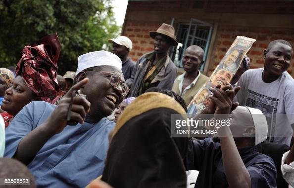 Malik Obama halfbrother of America's President elect Barack Obama sings with members of his family November 05 2008 at his Kogelo village residence...