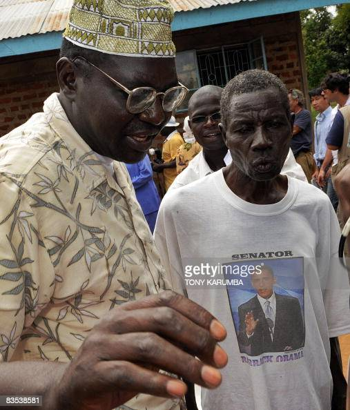 Malik Obama the halfbrother of US Democratic presidential hopeful Barak Obama talks to a relative at the Obama's rural home in the village of Kogelo...