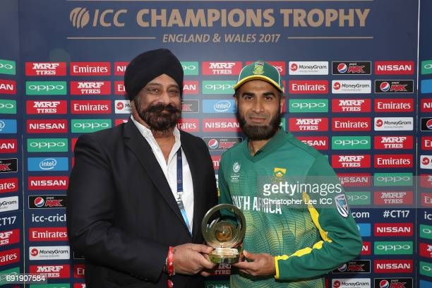 S Malik of OPPO presents Imran Tahir of South Africa with his Man of the Match award during the ICC Champions Trophy Group B match between Sri Lanka...