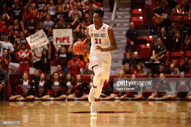 Malik Pope of the San Diego State Aztecs dribbles the ball in the second half of the game against the Utah State Aggies at Viejas Arena on January 31...