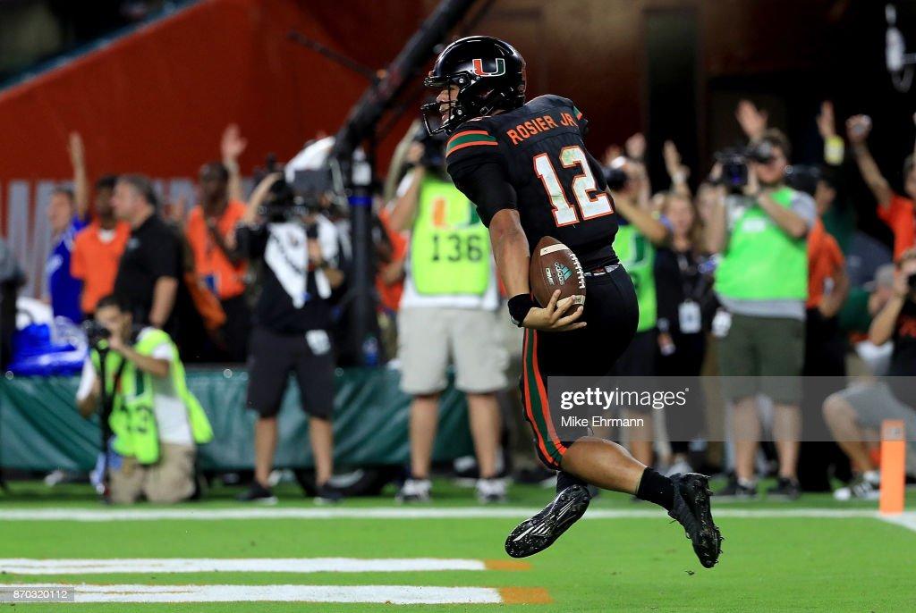 Malik Rosier #12 of the Miami Hurricanes celebrates a touchdown during a game against the Virginia Tech Hokies at Hard Rock Stadium on November 4, 2017 in Miami Gardens, Florida.