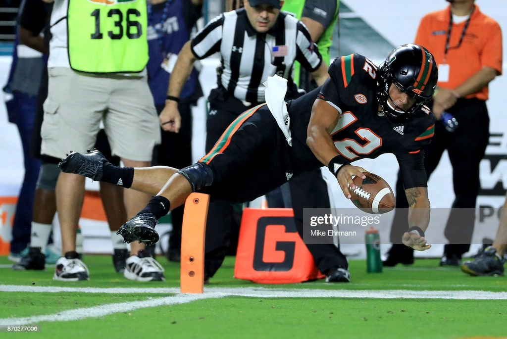 Malik Rosier #12 of the Miami Hurricanes rushes during a game against the Virginia Tech Hokies at Hard Rock Stadium on November 4, 2017 in Miami Gardens, Florida.
