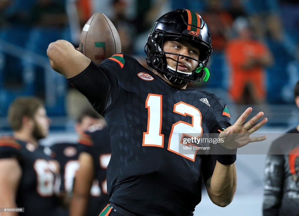 Malik Rosier #12 of the Miami Hurricanes warms up during a game against the Virginia Tech Hokies at Hard Rock Stadium on November 4, 2017 in Miami Gardens, Florida.