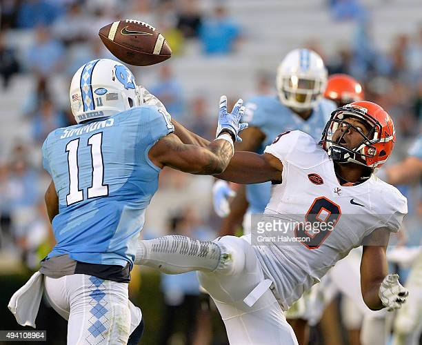 Malik Simmons of the North Carolina Tar Heels breaks up and then intercepts a pass intended for Canaan Severin of the Virginia Cavaliers during their...
