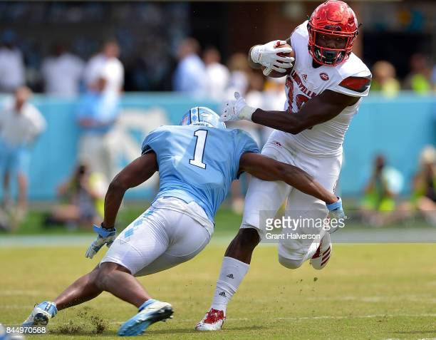 Malik Williams of the Louisville Cardinals breaks away from Myles Dorn of the North Carolina Tar Heels during the game at Kenan Stadium on September...