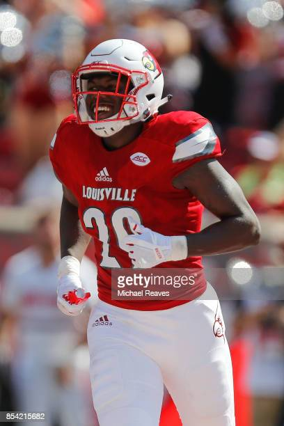 Malik Williams of the Louisville Cardinals celebrates after scoring a touchdown against the Kent State Golden Flashes at Papa John's Cardinal Stadium...