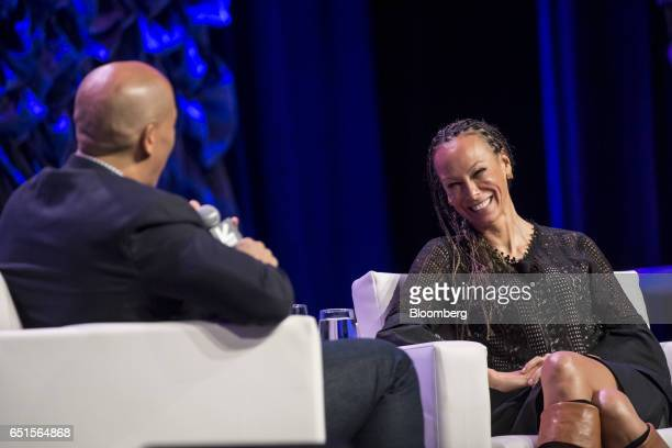 Malika Saada Saar senior counsel on civil and human rights for Google Inc right smiles as Senator Cory Booker a Democrat from New Jersey speaks...