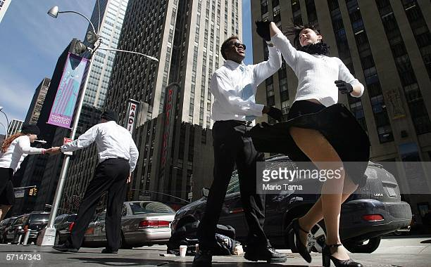 Malin Bergman and Samuel McKeown swing dance on Sixth Avenue during a promotion for USA Network's 'Show Us Your Character' contest March 21 2006 in...