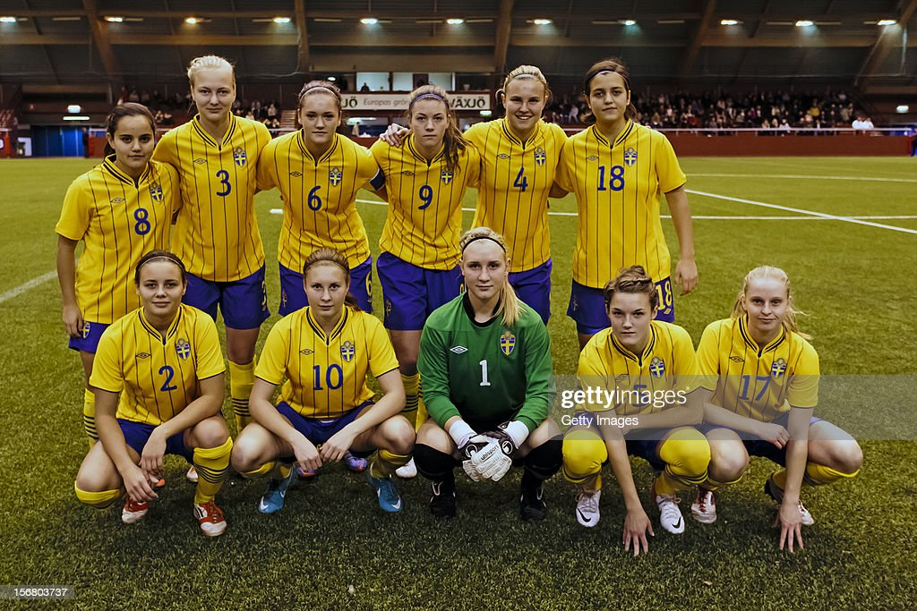 Malin Diaz Pettersson, Alexandra Benediktsson, Julia Wahlberg, Pauline Hammarlund, Elin Bergkvist, Marija Banusic, Alice Nilsson, Fanny Andersson, Louise Högrell, Saga Fredriksson, Sofia Anker-kofoed of Sweden pose for a team photo before the Under 19 Women's international friendly between Sweden and Germany, at Tipshallen Stadium on November 21, 2012 in Vaxjo, Sweden.