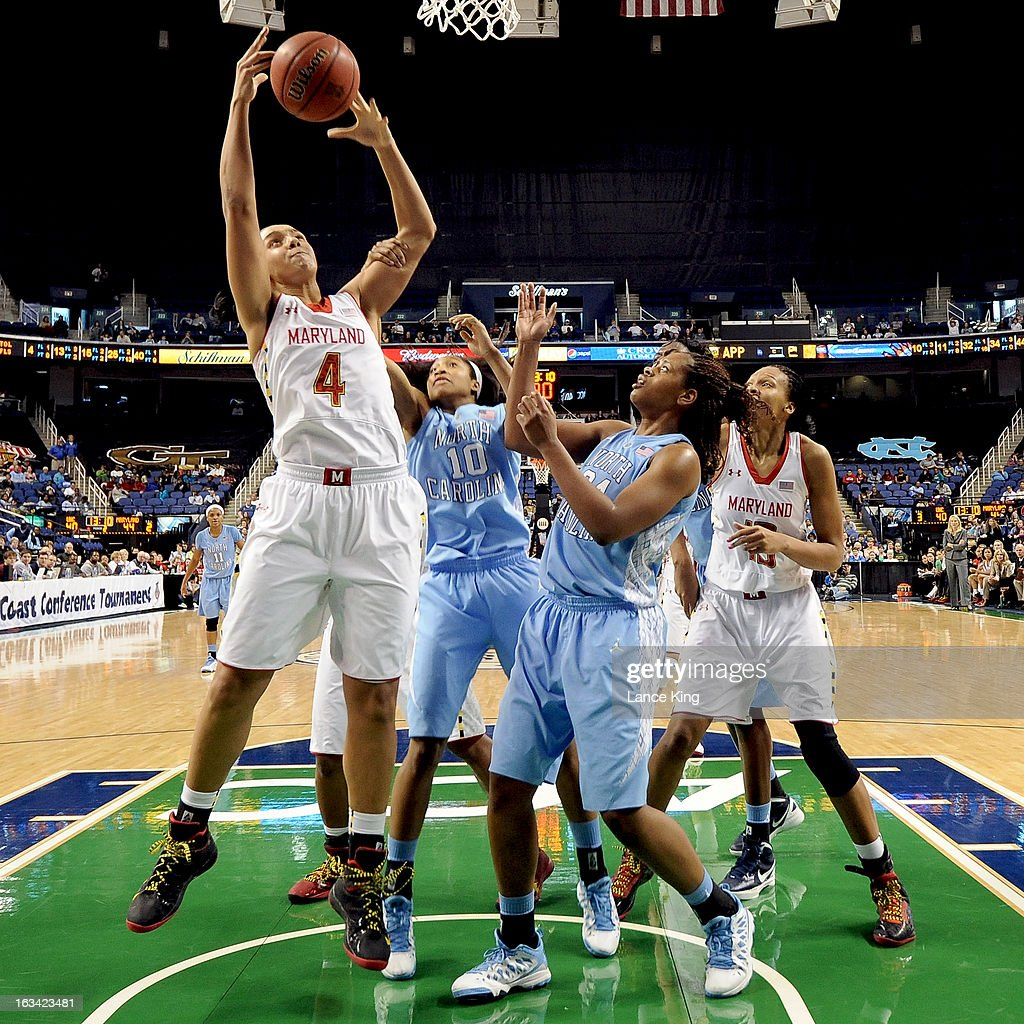 Malina Howard #4 of the Maryland Terrapins gets a defensive rebound against the North Carolina Tar Heels during the semifinals of the 2013 Women's ACC Tournament at the Greensboro Coliseum on March 9, 2013 in Greensboro, North Carolina.