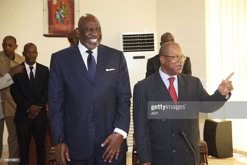Mali's former premier Cheick Modibo Diarra (L) arrives alongside his successor and replacement Prime Minister Diango Cissoko for a ceremony and press conference dedicated to the official handover of power between the two, in Bamako, on December 13, 2012. Mali's former premier, who was strongarmed into resigning by an ex-junta, met his replacement Prime Minister Diango Cissoko today for an official handover of power in Bamako. Diarra has said his main priorities are organising elections and wresting back control of northern Mali from Islamic hardliners who have occupied it for eight months and imposed brutal sharia law on the population.