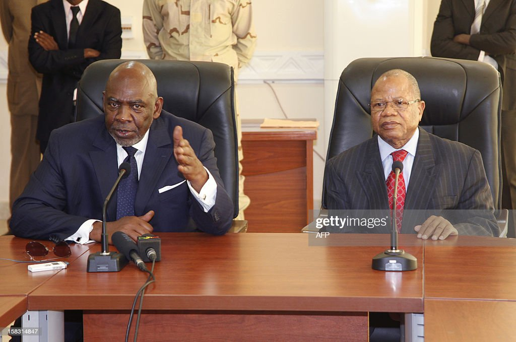 Mali's former premier Cheick Modibo Diarra (L) sits alongside his successor and replacement Prime Minister Diango Cissoko during a press conference dedicated to the official handover of power between the two, in Bamako, on December 13, 2012. Mali's former premier, who was strongarmed into resigning by an ex-junta, met his replacement Prime Minister Diango Cissoko today for an official handover of power in Bamako. Diarra has said his main priorities are organising elections and wresting back control of northern Mali from Islamic hardliners who have occupied it for eight months and imposed brutal sharia law on the population.
