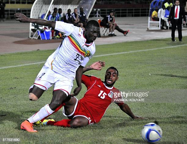 Mali's Hamari Traore fights for the ball with Guinea Equatorial' s Carlos Akapo during the 2017 African Cup of Nations qualification football match...