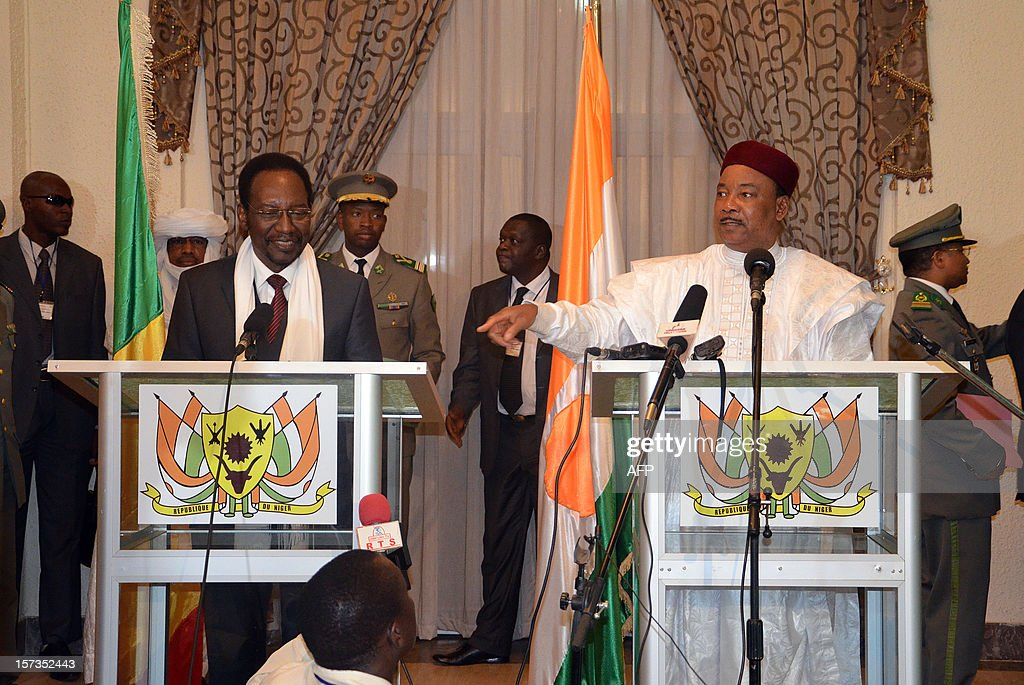 Mali's interim government President Dioncounda Traore (L) and Niger's President Mahamadou Issoufou (R) give a press conference at the presidential palace in Niamey, Niger, on December 2, 2012. Malian army colonel Alaji Ag Gamou, a Tuareg, who has been stationed for several months in Niger after Islamist militants took control of northern Mali, escaped an assassination attempt on December 2 in Niamey. Burkina Faso's President and Malian crisis mediator Blaise Compaore will present to Malian government representatives a 'negotiations agenda' with the Ansar Dine and National Movement for the Liberation of Azawad (MNLA) armed groups on December 3.