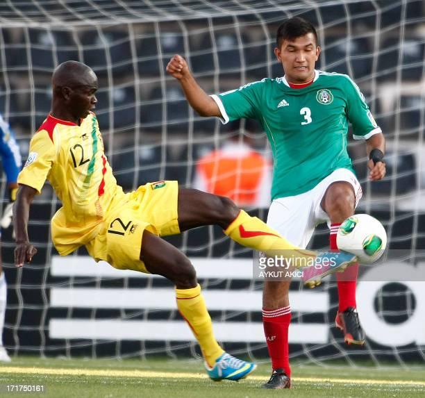 Mali's Mahamadou Traore vies with Mexico's Hedgardo Marin during a group stage football match between Mali and Mexico at the FIFA Under 20 World Cup...